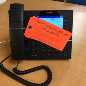 new College phone showing tag instructing community members to begin using this phone on June 11